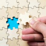 The last piece of a jigsaw wooden puzzle
